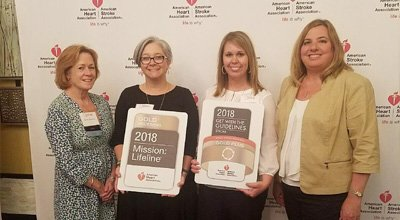 Nash co-workers accepting the AHA Gold Award