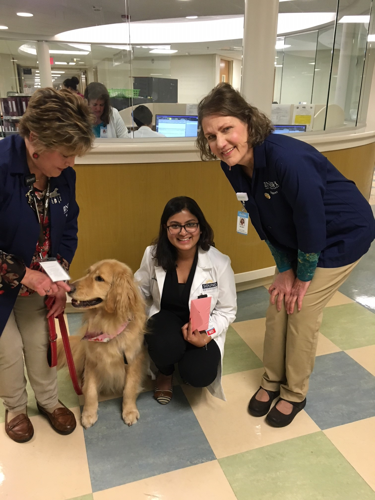 Pet therapy dog, Tucker, with doc and handlers