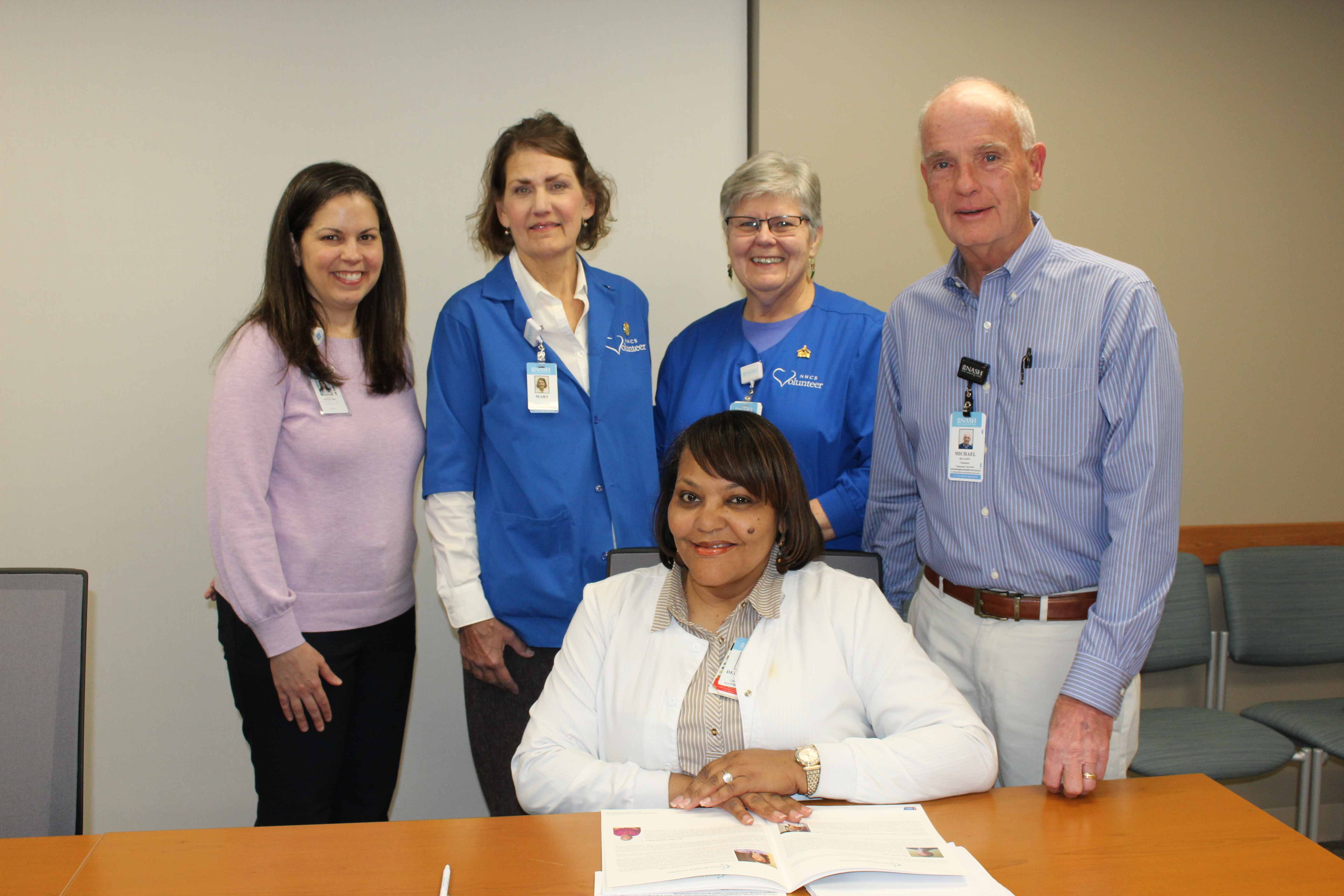 Delphine Wiggins shares information with Cancer Lay Navigation team